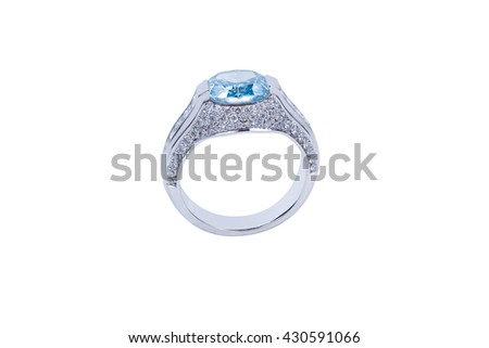 Jewelry silver ring with blue diamond on white background. Isolated - stock photo