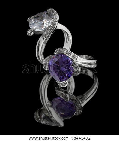 Jewelry silver rings with diamonds isolated on black background - stock photo