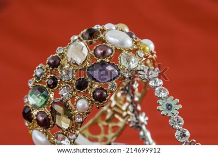 Jewelry women's dress. Some expensive But some cheap However, not much different beautiful gold jewelery - stock photo