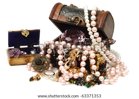 Jewelry wooden box full of gold and accessories - stock photo