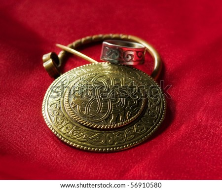 Jewels with ancient Slavic designs on a red background - stock photo