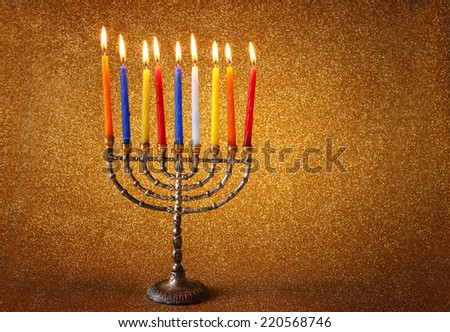 jewish holiday Hanukkah  background with  menorah Burning candles over golden dark glitter background - stock photo