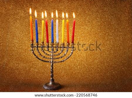 jewish holiday Hanukkah  background with  menorah Burning candles over golden dark glitter background - stock photo