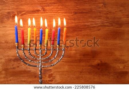 jewish holiday Hanukkah with menorah over wooden background  - stock photo