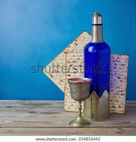 Jewish holiday Passover background with matzo and wine - stock photo