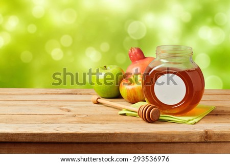Jewish holiday Rosh Hashana (new year) celebration with honey - stock photo