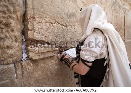 Jewish man praying at the Western wall in Jerusalem - stock photo