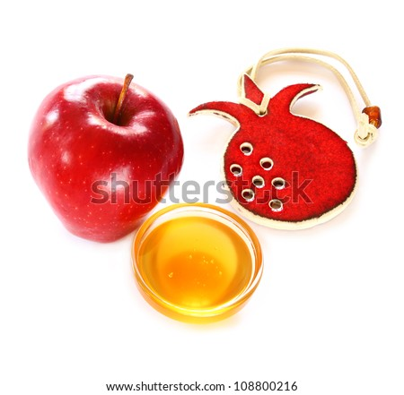 Jewish New Year - Rosh Hashanah ,  apple with honey isolated - stock photo