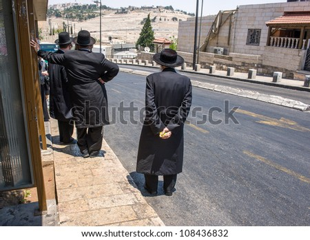 jewish orthodox men on the street in Jerusalem, Israel - stock photo