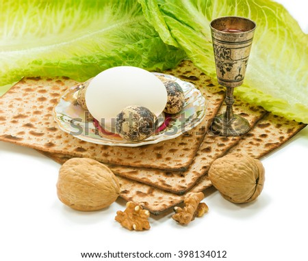 Jewish Passover traditional food: matzah (Jewish special bread for Passover) wine cup, salad, nuts and eggs. All elements are over white background. - stock photo