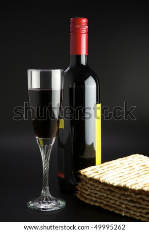 Jewish religious feast Passover traditional food Matza and red wine - stock photo