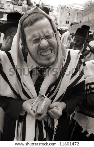 Jews pray in the wailing wall in Jerusalem on the holiday Pesakh. - stock photo