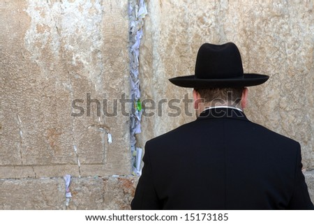 Jews praying at the Western Wall in Jerusalem. - stock photo