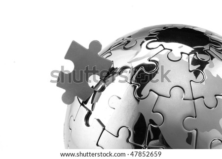 Jigsaw globe puzzle -Concept for solution - stock photo