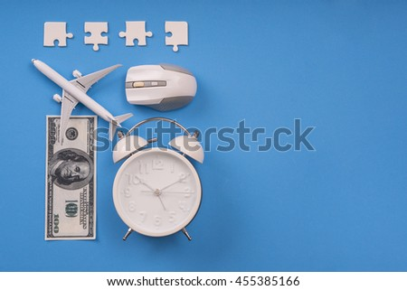 jigsaw, money, clock, airplane model  and computer mouse on blue background, Balance working concept. - stock photo