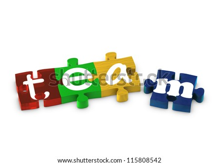 Jigsaw pieces spelling out TEAM - stock photo
