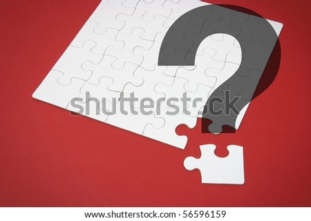 Jigsaw Puzzle and Question Mark on Red Background - stock photo