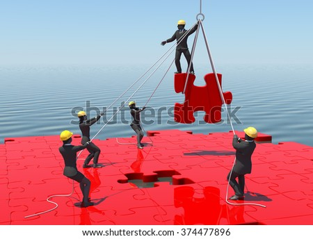 Jigsaw puzzle being built by teamwork by the sea at noon. A great jigsaw puzzle being built by a successful team  by the sea at noon. - stock photo