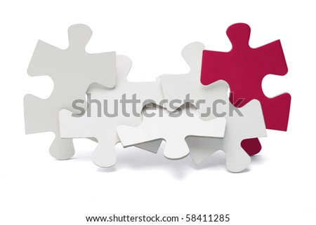 Jigsaw puzzle pieces interlocked and standing on white background