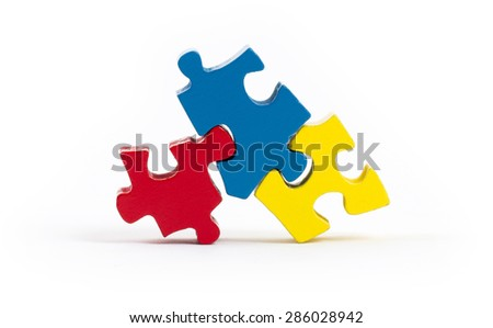 Jigsaw puzzle pieces isolated on a white background - stock photo