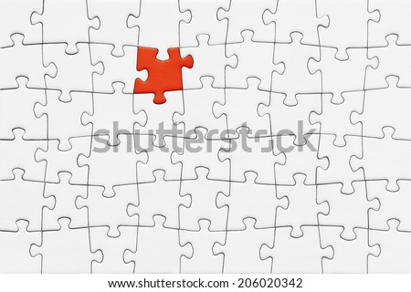 Jigsaw puzzle with blank white pieces and one red piece - stock photo