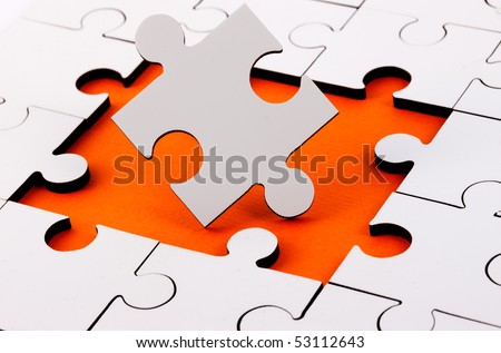 Jigsaw With Pieces Missing with orange underlay - stock photo
