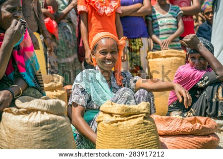 JIMMA, ETHIOPIA - MAY 2, 2015 : Ethiopian woman selling crops in a local crowded market. - stock photo