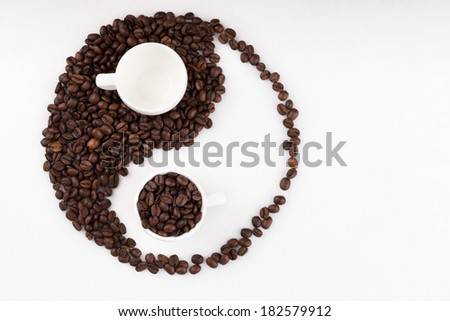 Jing jang sign made of coffee beans - stock photo