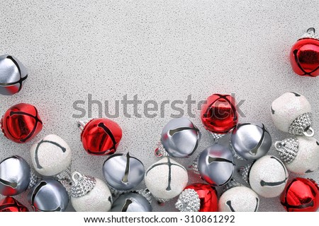 Jingle bells on silver background - stock photo