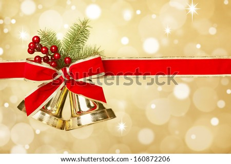 Jingle bells with red ribbon bow on festive background - stock photo