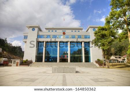 "Jingxi, China-Jan.18: China-Vietnam border port. The characters at the top mean ""The People's republic of China"" and The characters on the gate mean "" Enter"". Jingxi county, Guangxi Province, China"