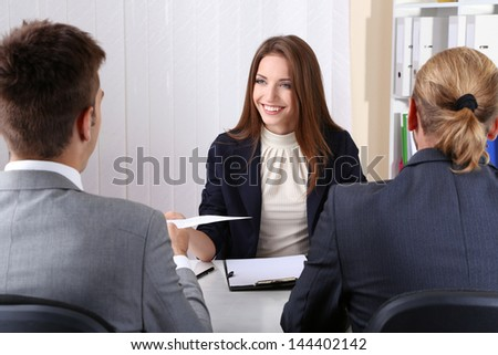 Job applicants having interview - stock photo