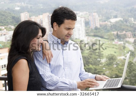 Job at home, lovely couple working at home - stock photo