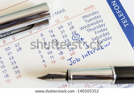 Job interview date is marked on the calendar - stock photo