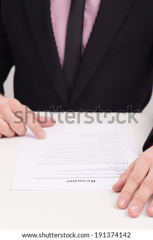 Job Interview. Someone looking over a submitted resume, or a person editing their own resume - stock photo