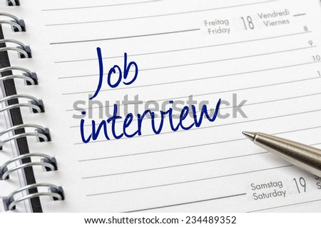 Job interview written on a calendar page - stock photo
