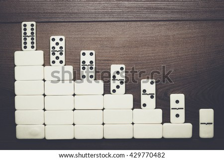 job ladder concept. domino pieces forming stair over wooden background - stock photo