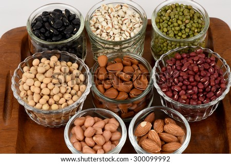 Job's tears, Soy beans, Red beans, black beans, Peanut, pine nut, Almond  and green beans with the health benefits of whole grains. - stock photo