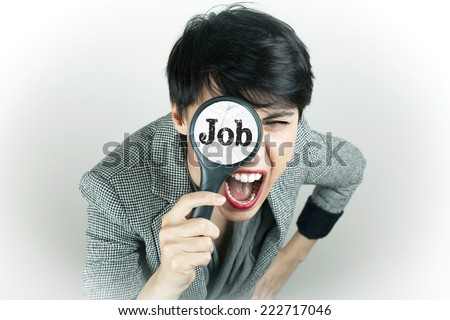 Job Search Concept Woman with Magnifying Glass - stock photo