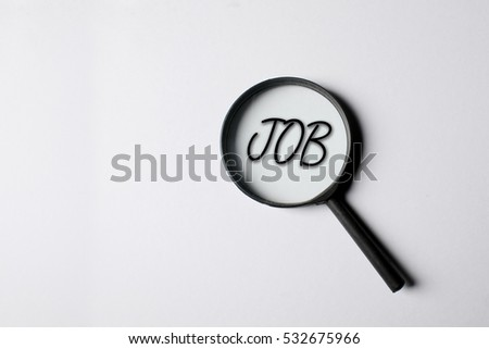 Job word through a magnifying glass. Magnifying glass search concept. Isolated on white background.