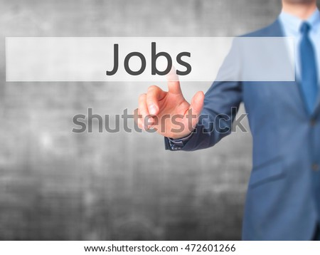 Jobs - Businessman press on digital screen. Business,  internet concept. Stock Photo
