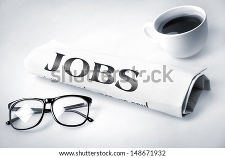 Jobs word on newspaper
