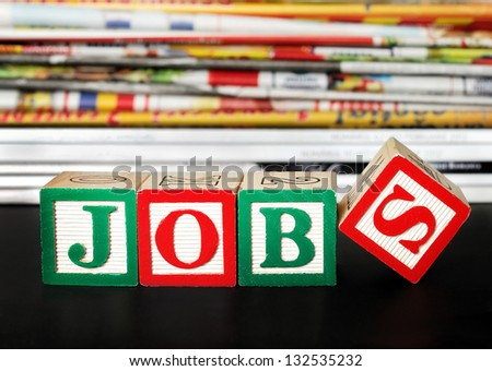 Jobs word with newspapers background - stock photo