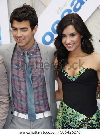 Joe Jonas and Demi Lovato at the Los Angeles premiere of 'Oceans' held at the El Capitan Theater in Hollywood, USA on April 17, 2010.  - stock photo