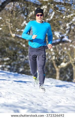 jogger in snow - stock photo