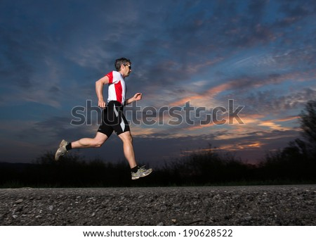 jogger in sunrise - stock photo