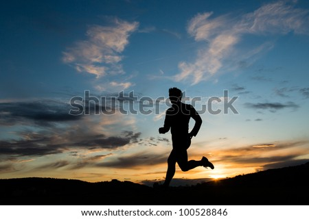 jogger in sunset - stock photo