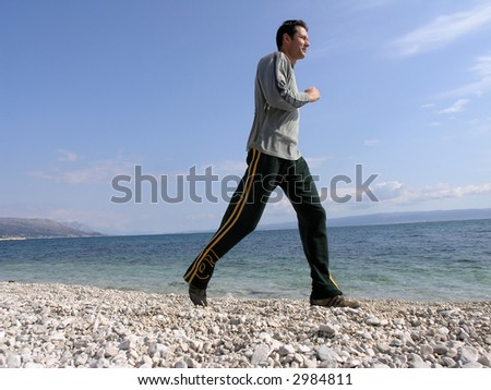 Jogging at the beach - stock photo