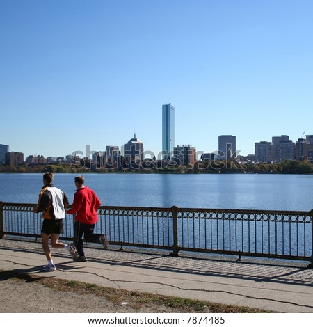 jogging by the Charles River with part of the boston Skyline - stock photo