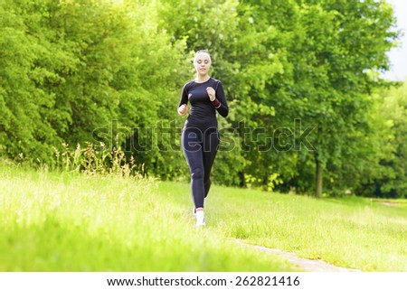 Jogging Concept: Caucasian Fit Woman Having Her Jogging Training Outside in Forest. Horizontal Image Composition - stock photo